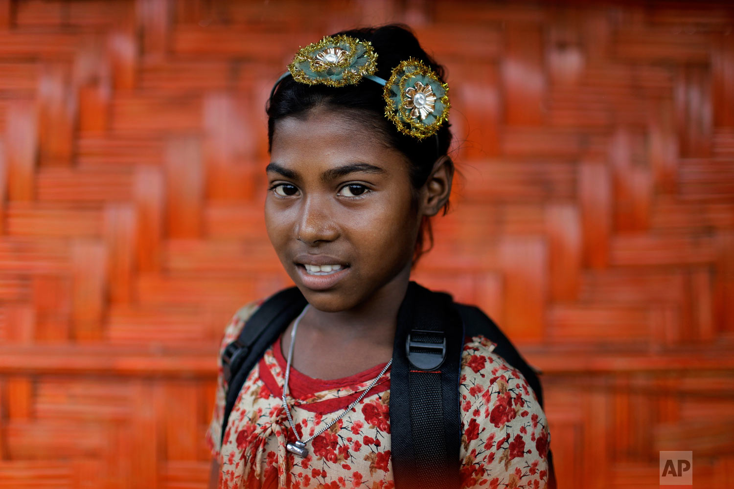 Zesmin, 10, poses for a portrait in front of her classroom on June 27, 2018, in Chakmarkul refugee camp, Bangladesh. (AP Photo/Wong Maye-E)