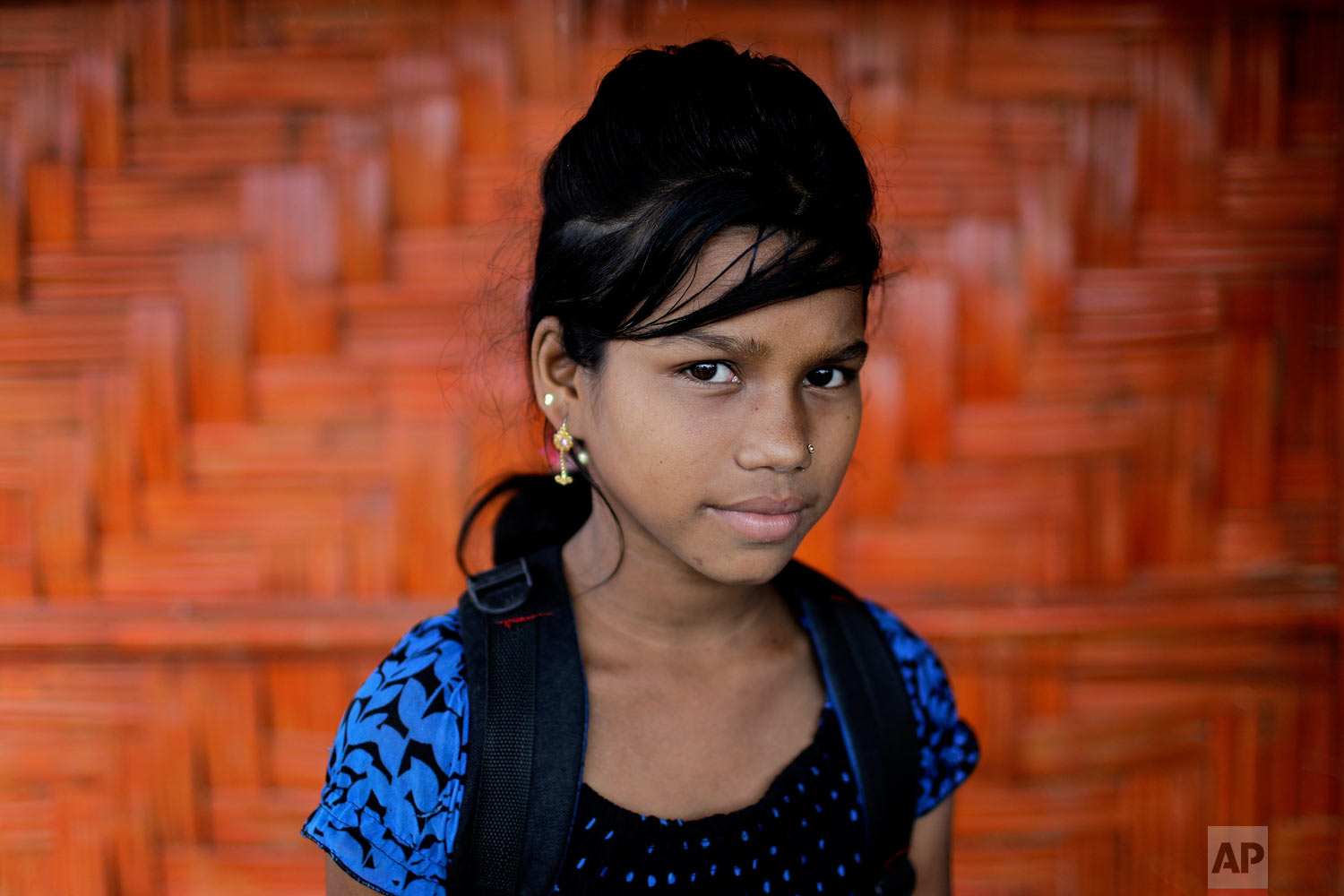 Astafa, 10, poses for a portrait in front of her classroom on June 27, 2018, in Chakmarkul refugee camp, Bangladesh. (AP Photo/Wong Maye-E)