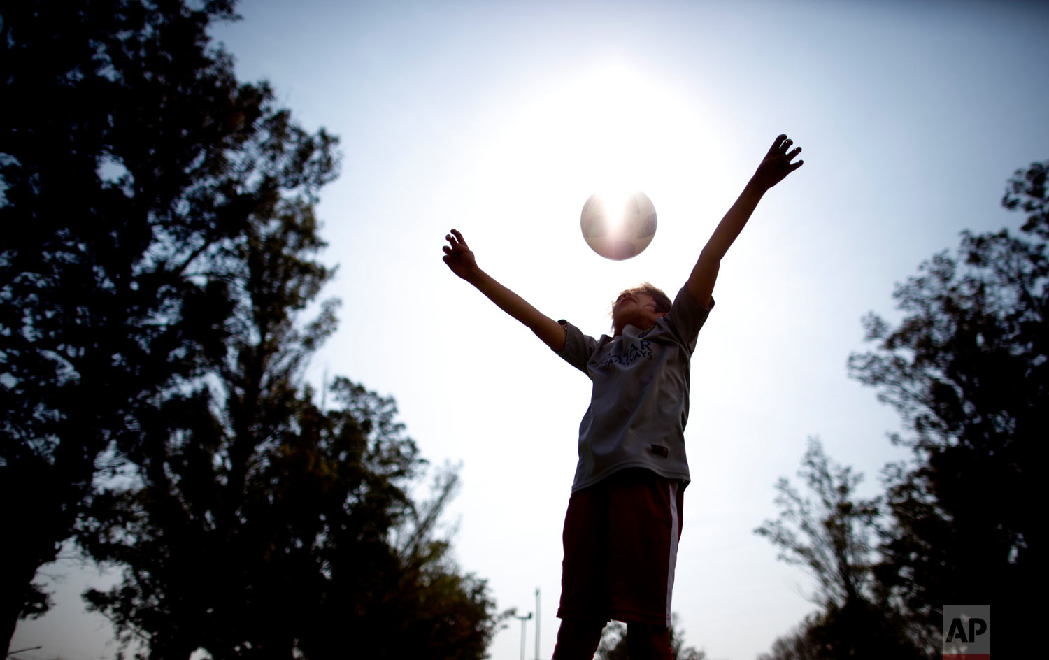 """Candelaria Cabrera plays with a soccer ball in Chabas, Argentina on Saturday, Sept. 8, 2018. """"Cande,"""" as she is known by friends and family, is the only girl playing in a children's soccer league in the southern part of Argentina's Santa Fe province, birthplace of stars including Lionel Messi, Gabriel Batistuta and Jorge Valdano. (AP Photo/Natacha Pisarenko)"""