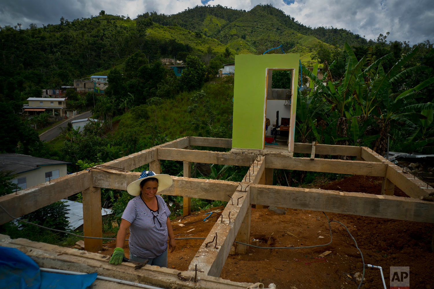 Alma Morales Rosario stands in her home that is being rebuilt. Sept. 8, 2018. (AP Photo/Ramon Espinosa)
