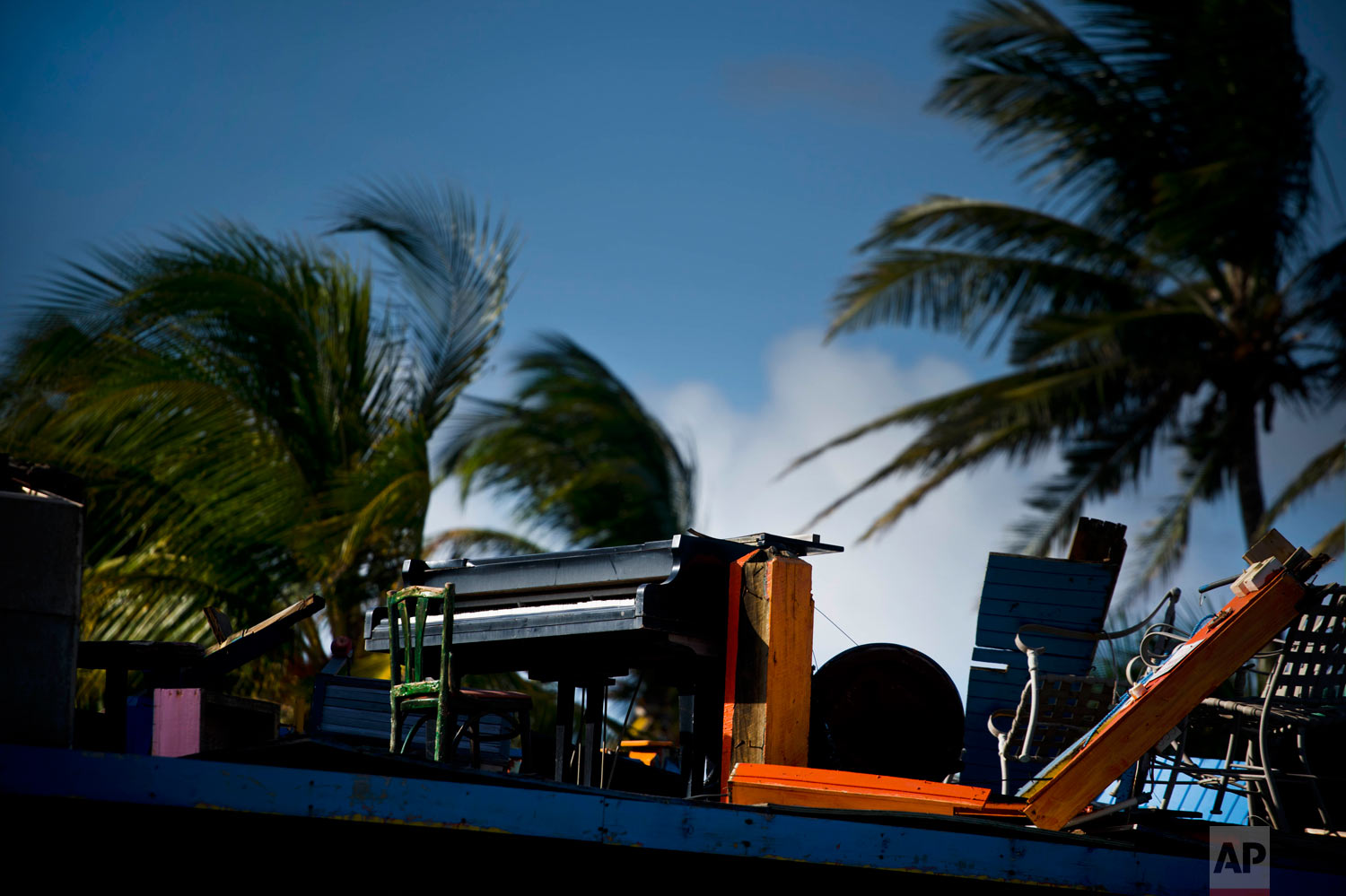 In this Sept. 12, 2018 photo, a piano remains standing in a restaurant destroyed one year ago by Hurricane Maria in Toa Baja, Puerto Rico. (AP Photo/Ramon Espinosa)