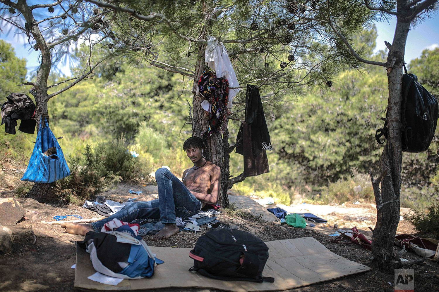 Tresor-Debrun, a Cameroonian migrant, poses for a portrait as he takes shelter in a forest near Masnana, Sept. 5, 2018, on the outskirts of Tangier, Morocco. (AP Photo/Mosa'ab Elshamy)