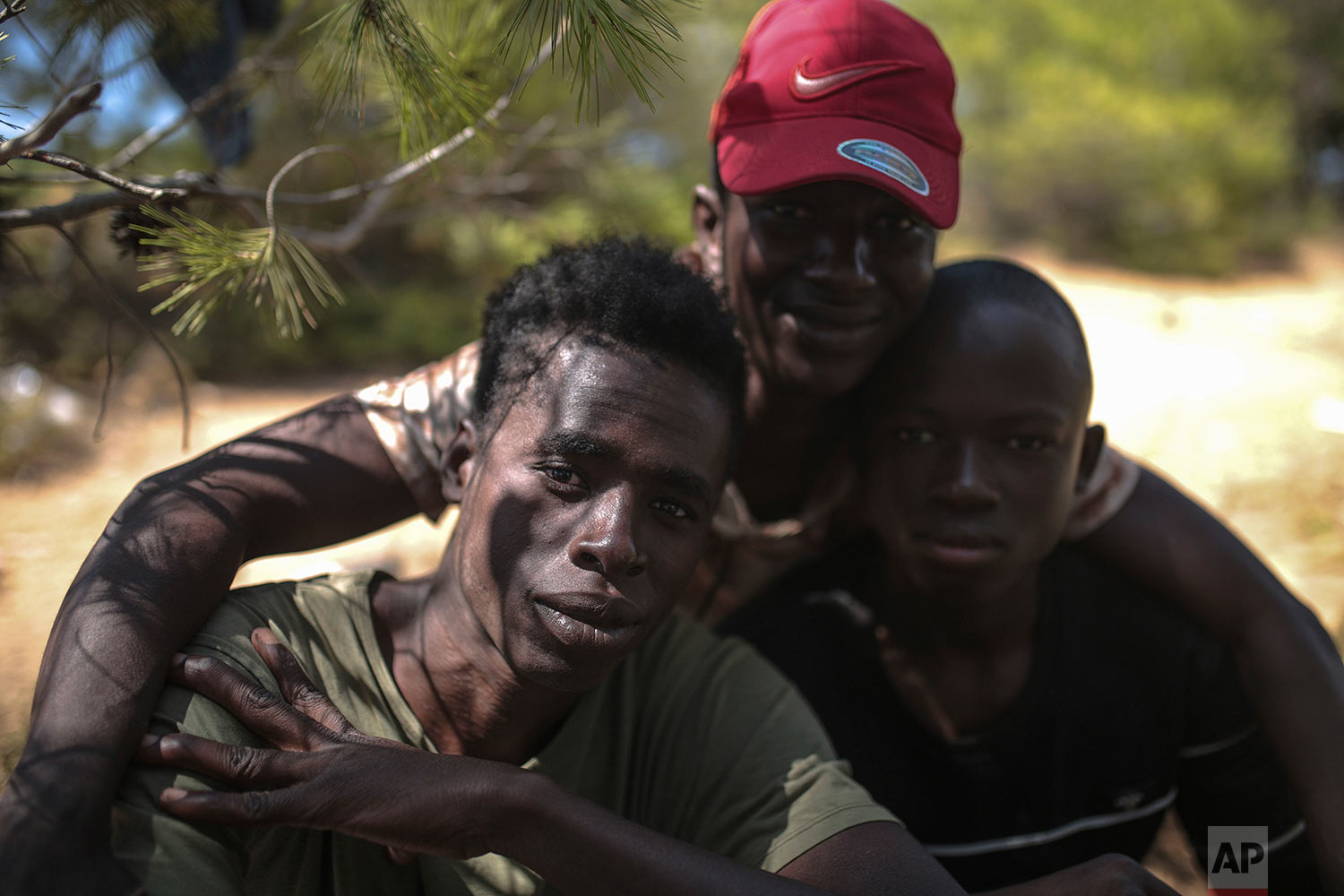 Sub-Saharan migrants pose for a portrait as they take shelter in a forest near Masnana, Sept. 5, 2018, on the outskirts of Tangier, Morocco. (AP Photo/Mosa'ab Elshamy)
