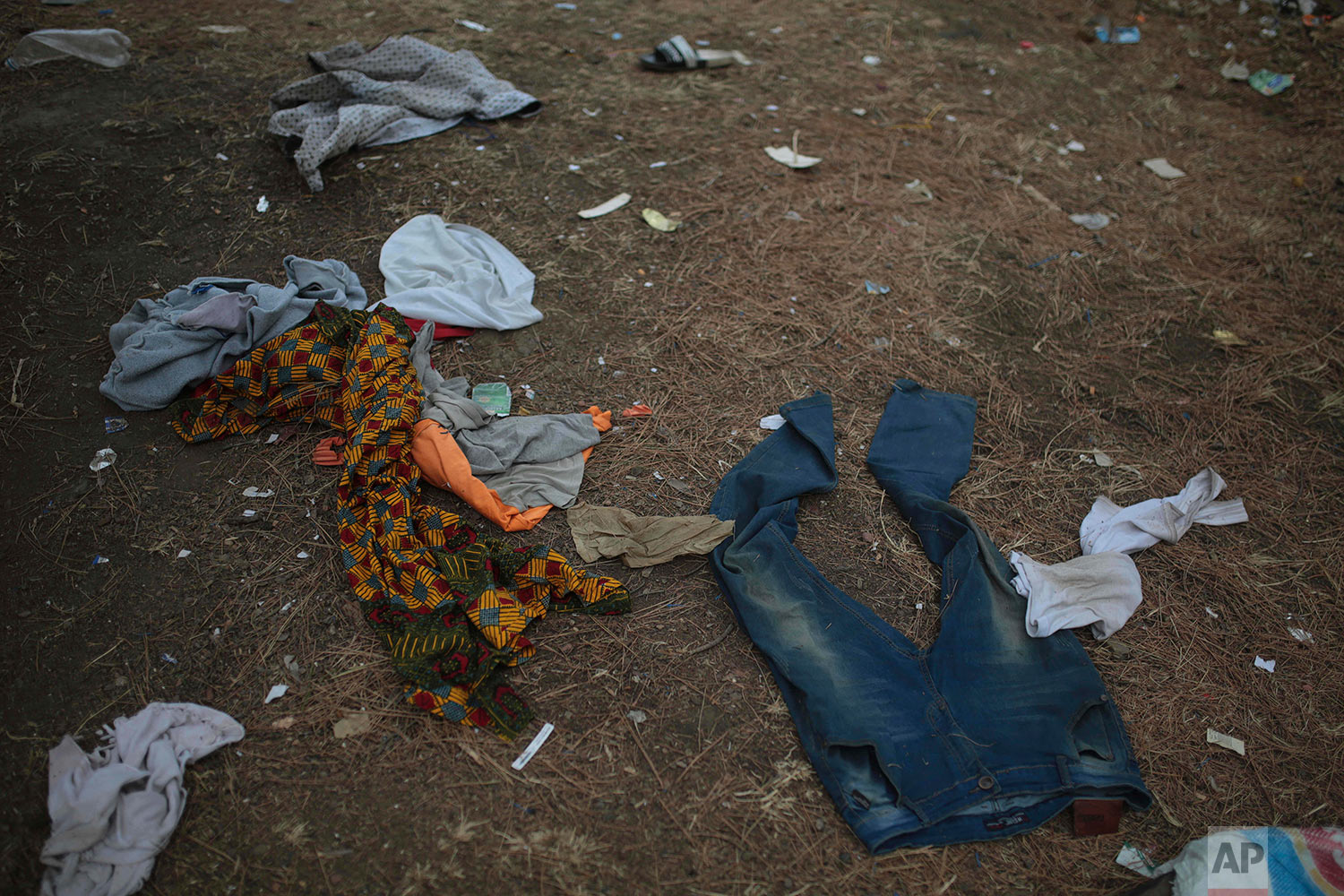 Clothes belonging to sub-Saharan migrants aiming to cross to Europe are scattered on in a forest following a police raid, near Masnana, Sept. 8, 2018, on the outskirts of Tangier, Morocco. (AP Photo/Mosa'ab Elshamy)