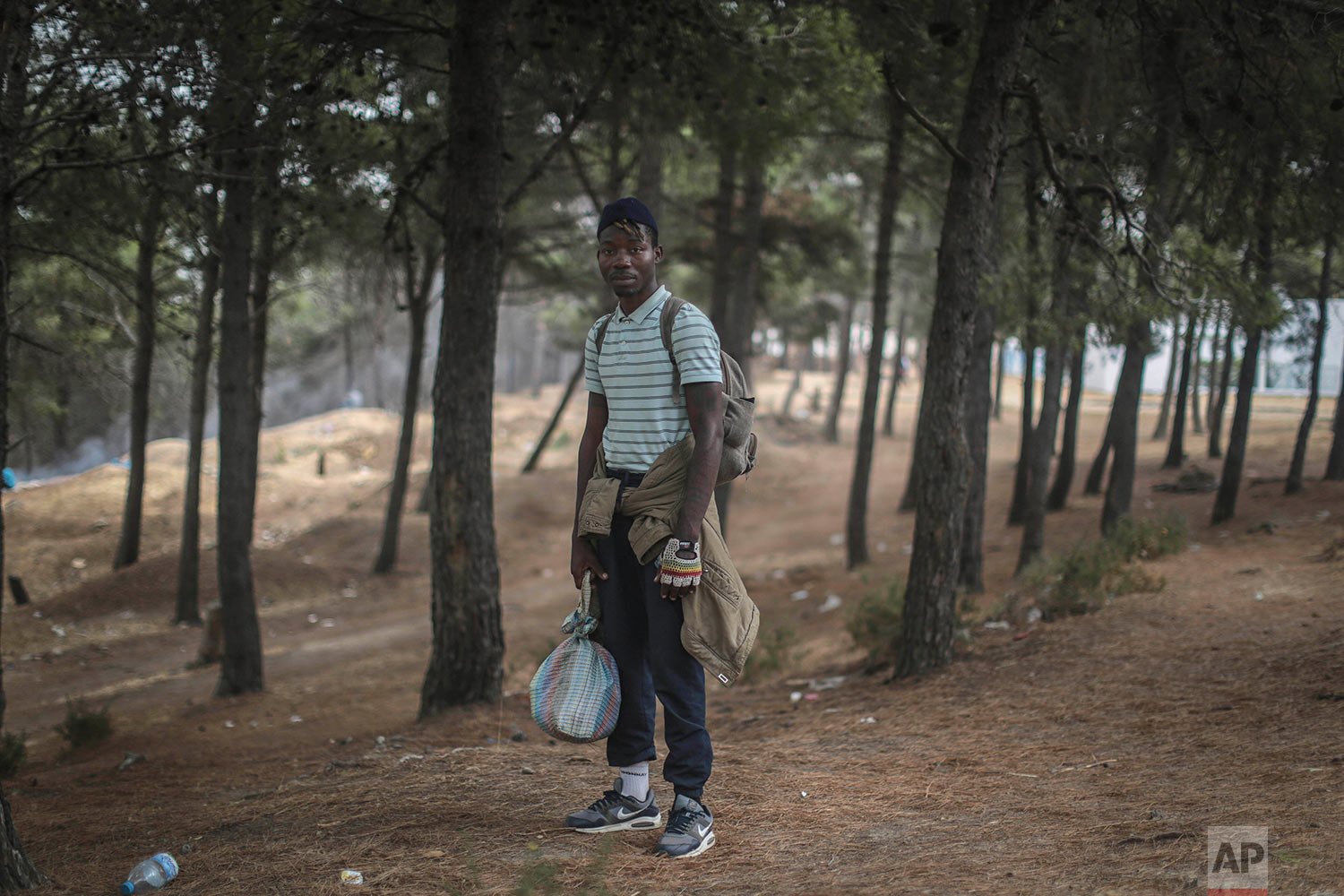 Alex Brandan, a Cameroonian migrant, poses for a portrait as he takes shelter in a forest near Masnana, Sept. 8, 2018, on the outskirts of Tangier, Morocco. (AP Photo/Mosa'ab Elshamy)