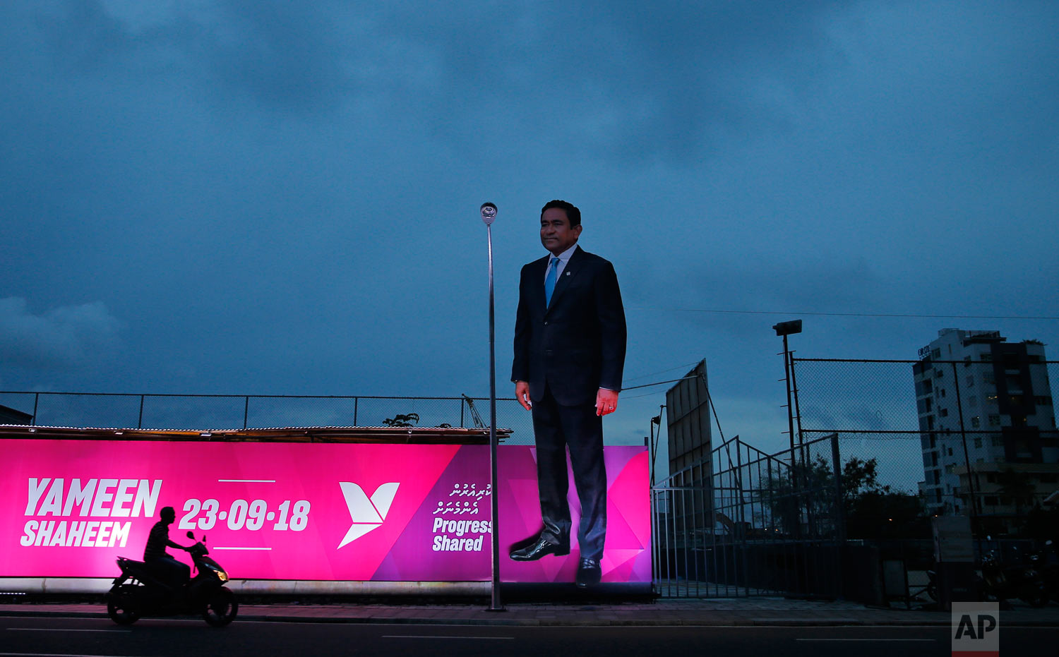A giant cut-out of Maldivian President Yameen Abdul Gayoom stands on a road ahead of Sunday's elections in Male, Maldives, Friday, Sept. 21, 2018. A decade after Maldivians took to the streets to welcome democracy to the series of coral atolls in the Indian Ocean, voters head to the ballot box in what has become a referendum on whether democracy will stay. (AP Photo/Eranga Jayawardena)