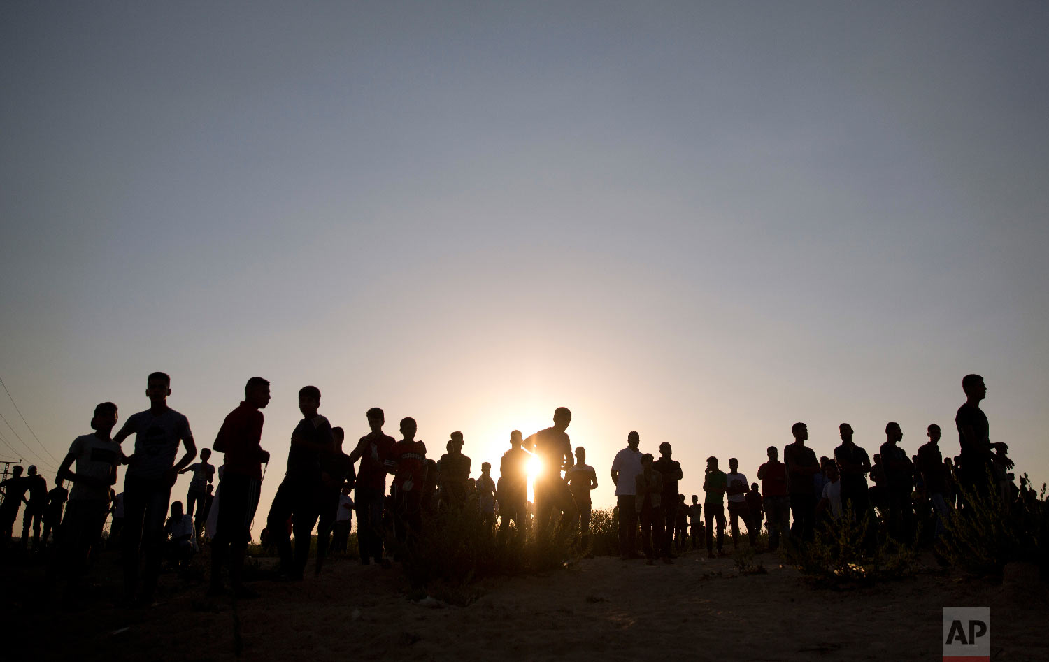 Palestinians protest at the entrance of Erez border crossing between Gaza and Israel, in the northern Gaza Strip, Sept. 26, 2018. (AP Photo/Khalil Hamra)