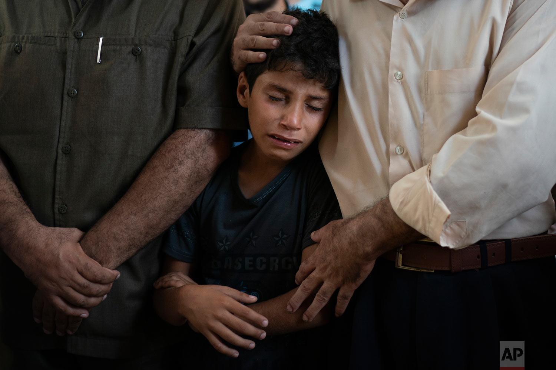 Mahmoud Abdel-al, 11, cries during the funeral of his twin brother Shady Abdel-al in Beit Lahiya, Gaza Strip, Sept. 15, 2018. (AP Photo/Felipe Dana)