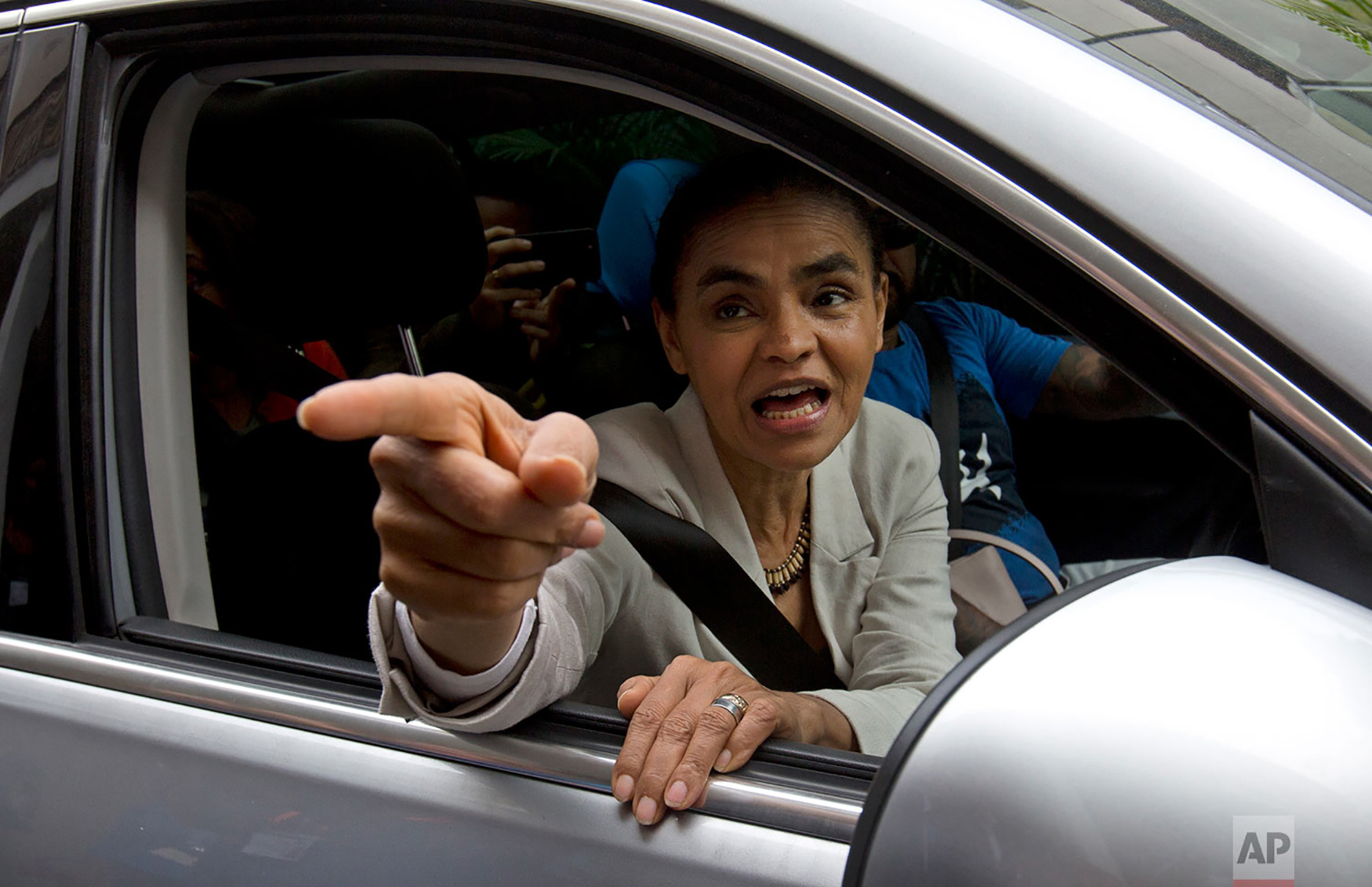 "Marina Silva, presidential candidate for the Sustainability Network Party, talks to supporters after visiting the ""Saude Crianca"" Association as she campaigns in Rio de Janeiro, Brazil, Sept. 11, 2018. The children's health organization works with poor families with children suffering chronic disease. Brazil will hold elections in October. (AP Photo/Silvia Izquierdo)"