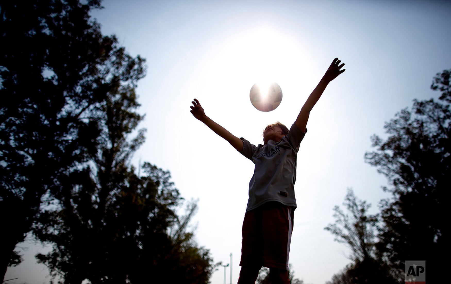 "Candelaria Cabrera plays with a soccer ball in Chabas, Argentina, Sept. 8, 2018. ""Cande,"" as she is known by friends and family, is the only girl playing in a children's soccer league in the southern part of Argentina's Santa Fe province, birthplace of stars including Lionel Messi, Gabriel Batistuta and Jorge Valdano. (AP Photo/Natacha Pisarenko)"