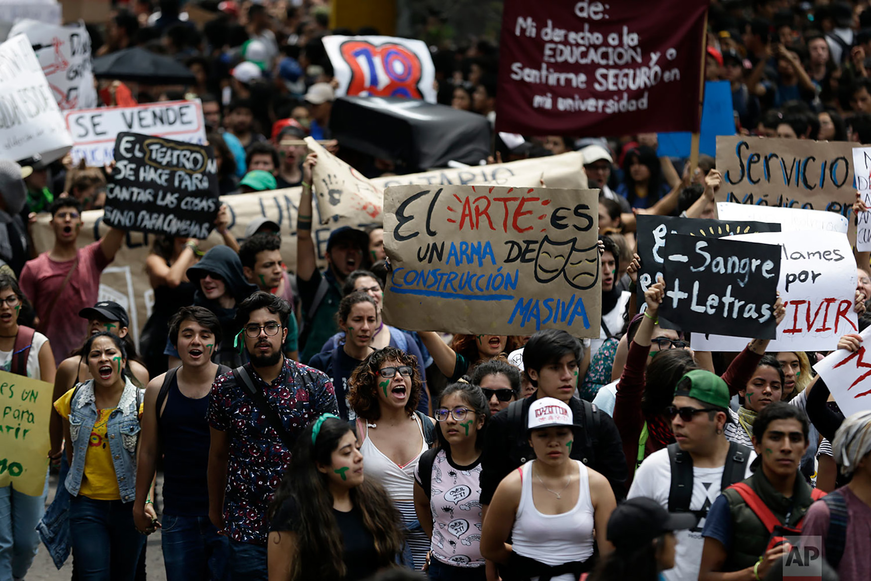 "Thousands of students at Mexico's National Autonomous University protest to demand an end to violence by groups of thugs known as ""porros,"" who are often registered but don't attend classes, at the University's main campus in Mexico City, Sept. 5, 2018. (AP Photo/Rebecca Blackwell)"