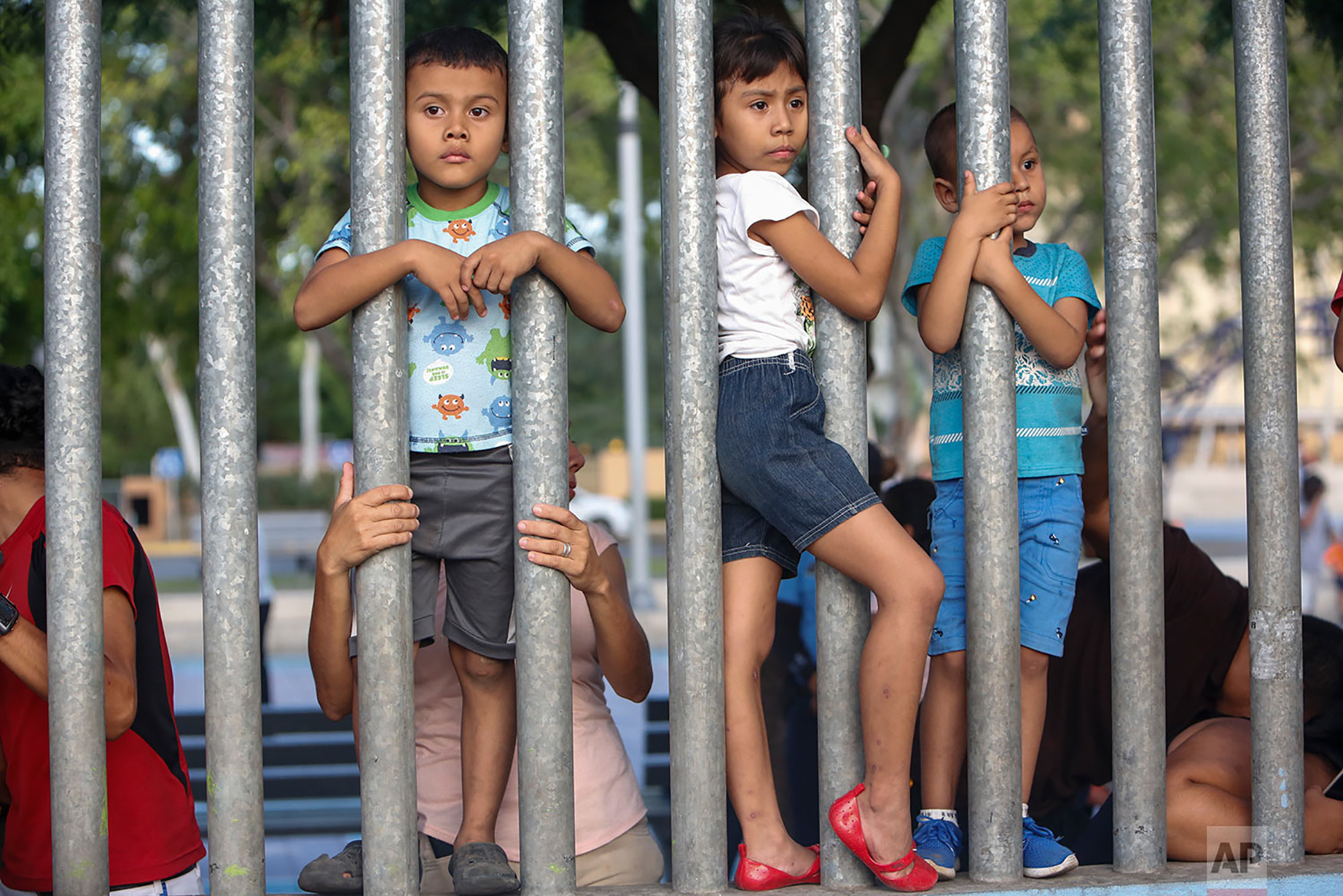 Children watch the Independence Day celebrations in Managua, Nicaragua, Sept. 15, 2018. Nicaragua is marking their 1821 independence from Spain. (AP Photo/Alfredo Zuniga)