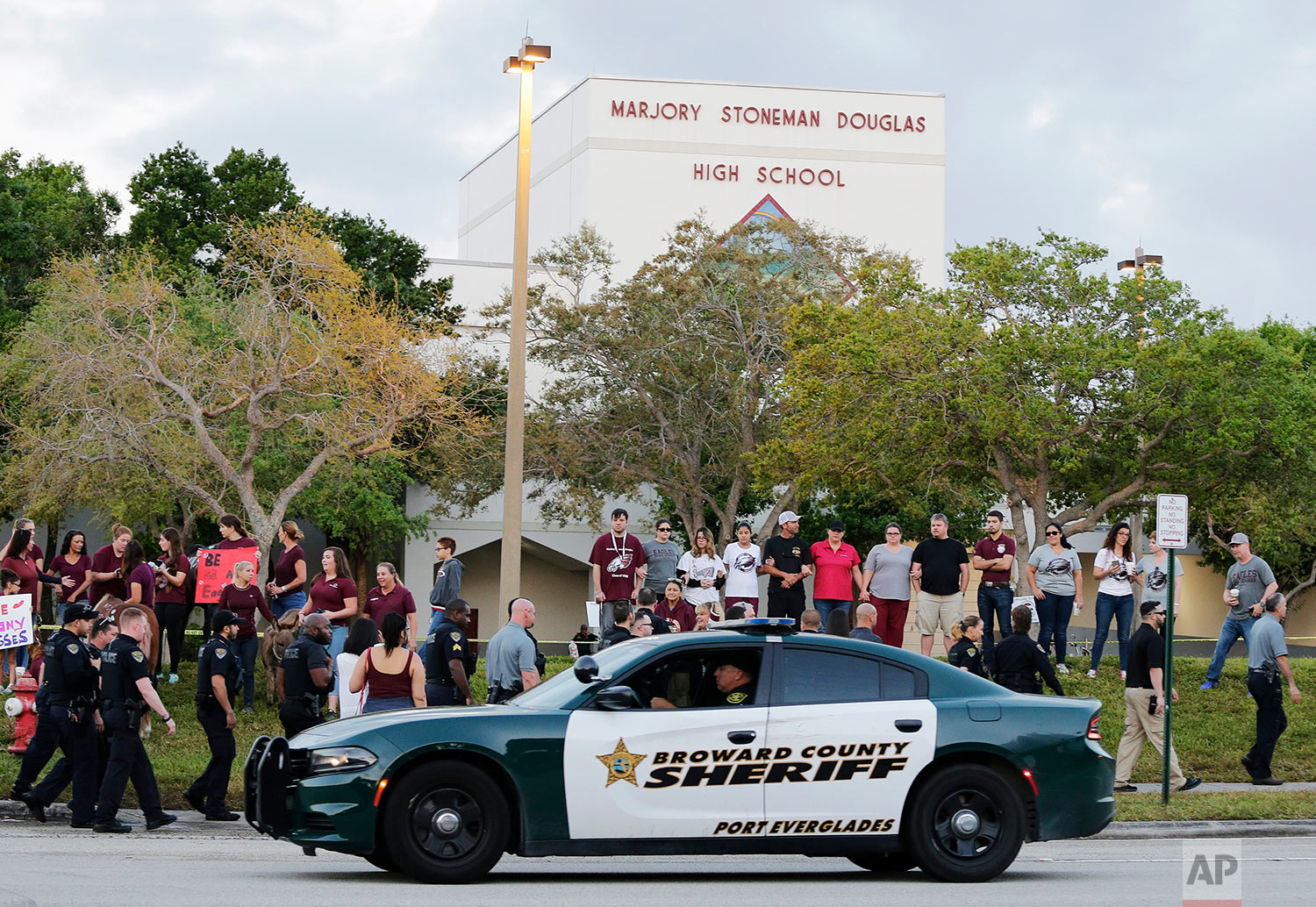A heavy law enforcement presence greeted Marjory Stoneman Douglas High School students on their first day back to class in Parkland, Fla., on Feb. 28, 2018. (AP Photo/Terry Renna)