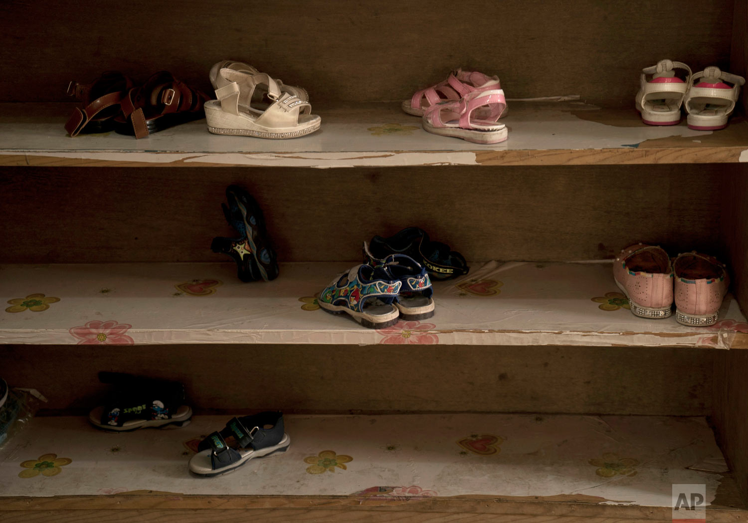 Shoes are stacked on shelves at Salhiya Orphanage in Baghdad, Iraq. (AP Photo/Maya Alleruzzo)