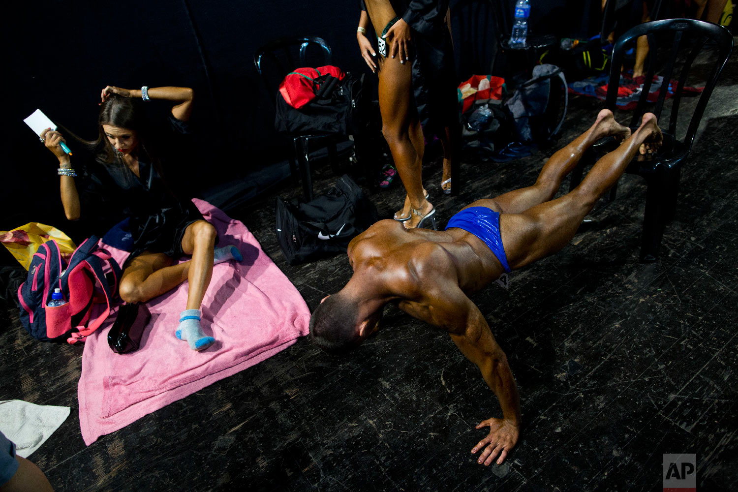 Contestants get ready backstage during the National Amateur Body Builders' Association competition in Tel Aviv, Israel on Oct. 18, 2018. (AP Photo/Oded Balilty)