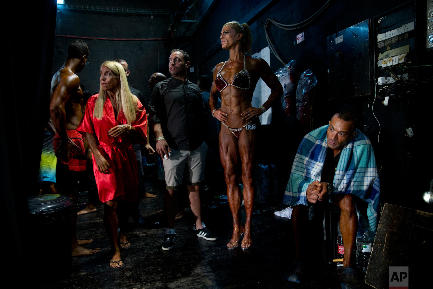 Contestants wait for their performance backstage during the National Amateur Body Builders' Association competition in Tel Aviv, Israel on Oct. 18, 2018. (AP Photo/Oded Balilty)