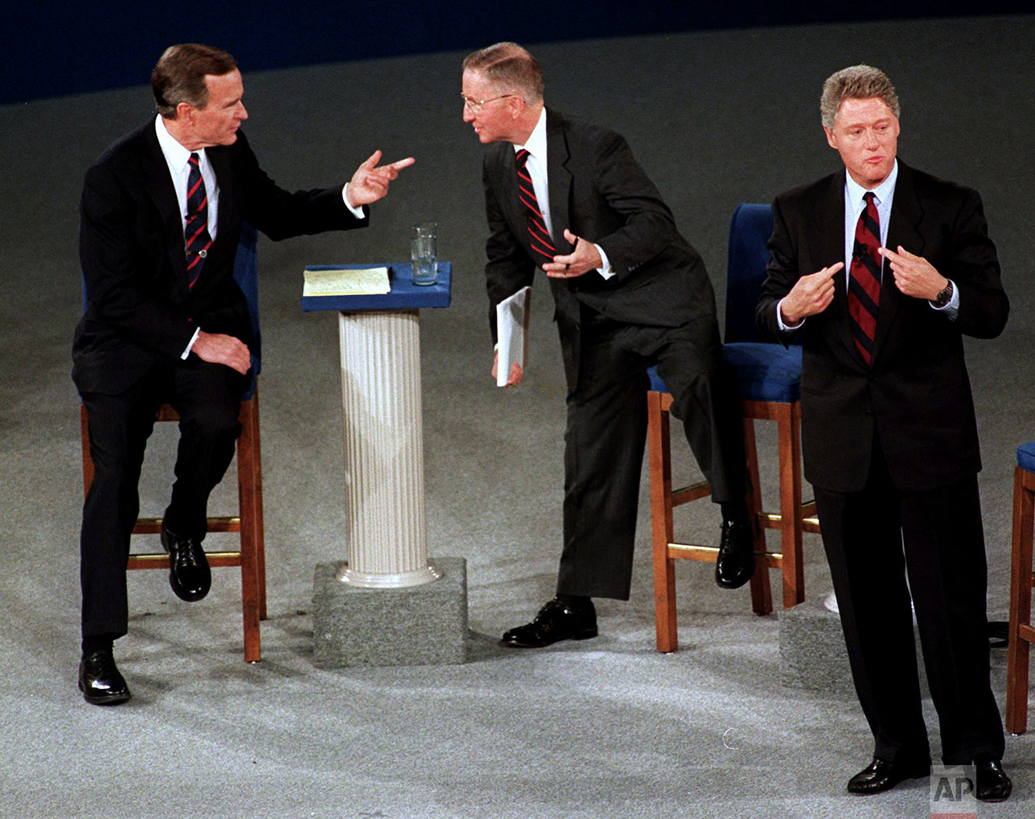 President Bush, left, talks with independent candidate Ross Perot as Democratic candidate Bill Clinton stands aside at the end of their second presidential debate Oct. 15, 1992, in Richmond, Va. (AP Photo/Marcy Nighswander)