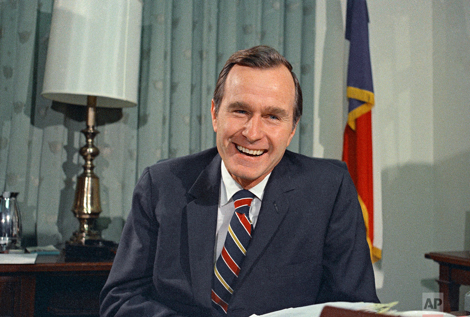 Newly appointed United Nations Ambassador George H.W. Bush smiles on Dec. 18, 1970. (AP Photo/John Duricka)