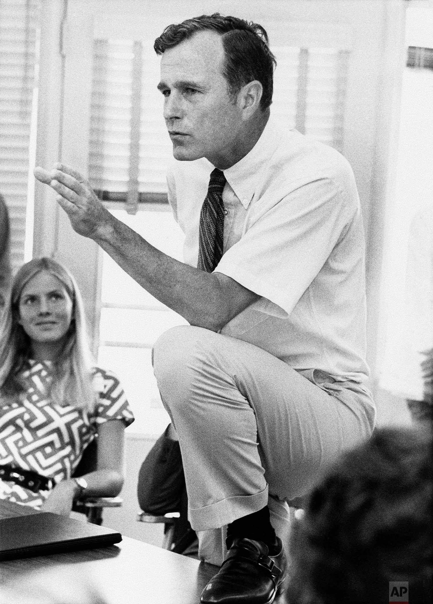 Rep. George H.W. Bush, R-Texas., who is seeking a seat in U.S. Senate, talks with a group of young people at a rally in Houston on Oct. 9, 1970. (AP Photo)