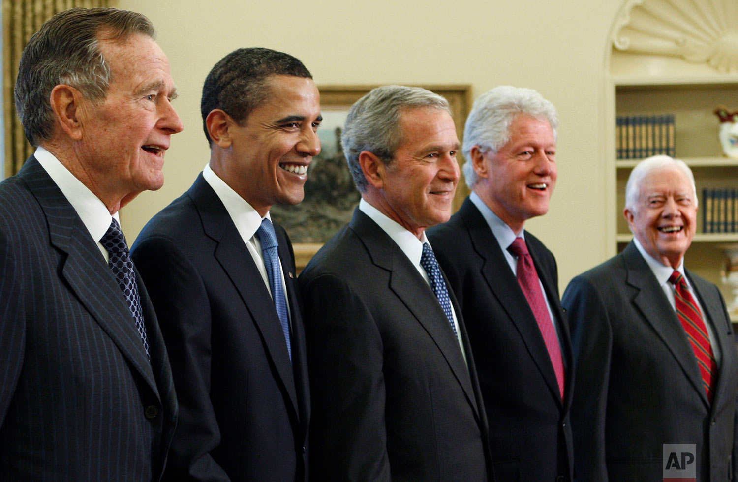 President George W. Bush, center, poses with President-elect Barack Obama, and former presidents, from left, George H.W. Bush, left, Bill Clinton and Jimmy Carter, right, Jan. 7, 2009, in the Oval Office of the White House in Washington. (AP Photo/J. Scott Applewhite, File)