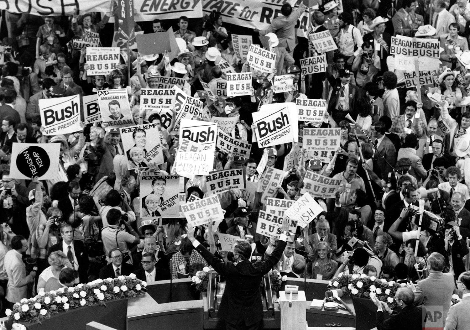 George H.W. Bush, center foreground, acknowledges the crowd before speaking to the Republican Convention delegates on July 16, 1980, in Detroit. (AP Photo)