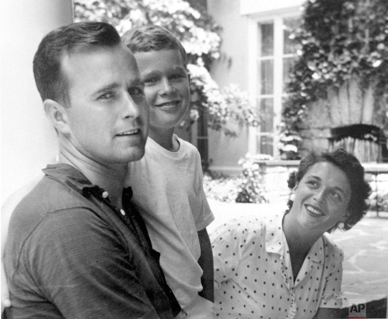 George H.W. Bush, left, and Barbara Bush pose with their son, George W. Bush, in 1955, in Rye, N.Y. (George Bush Presidential Library via AP)