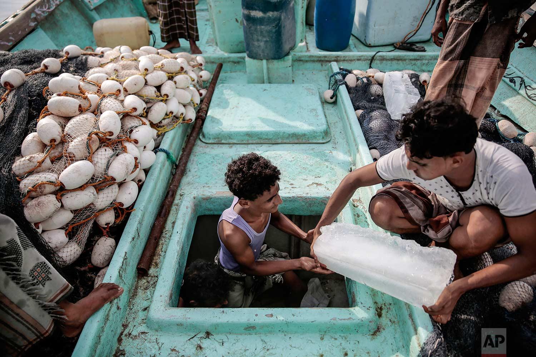 In this Sept. 29, 2018, photo, Yemeni fishermen work on their boat at the main fishing port, in Hodeida, Yemen. (AP Photo/Hani Mohammed)