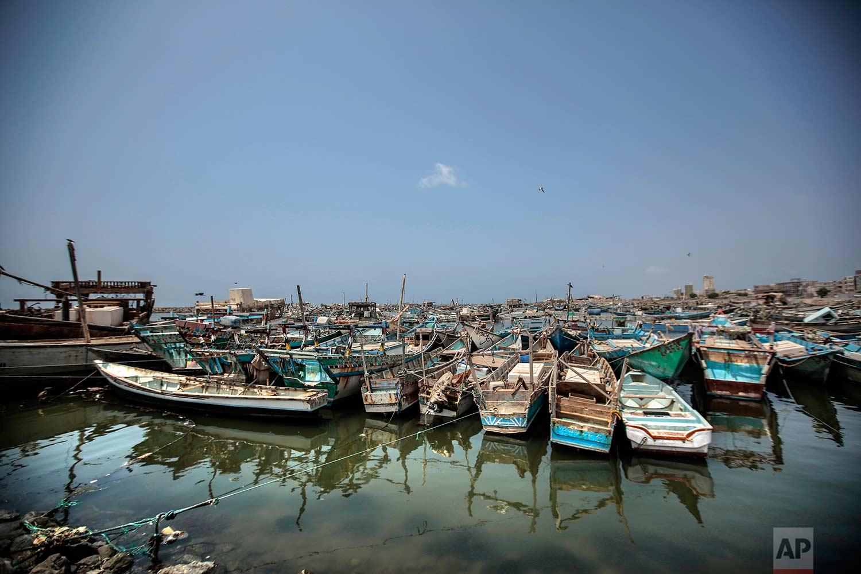 This Sept. 29, 2018, photo, shows fishing boats docked at the main fishing port, in Hodeida, Yemen. (AP Photo/Hani Mohammed)