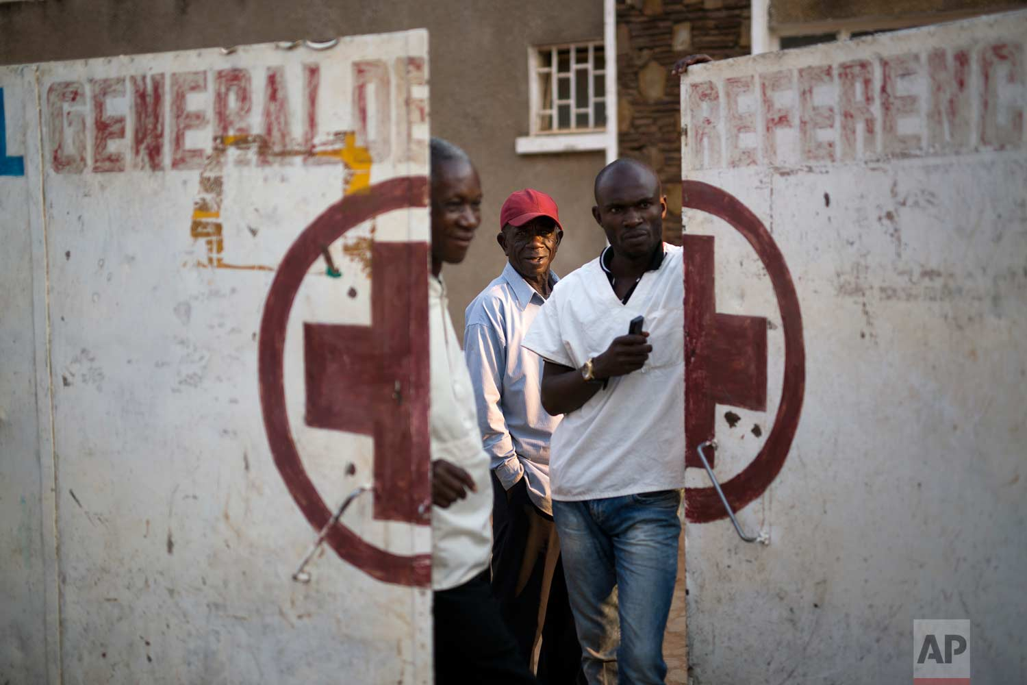 Employees guard the door of the Katuba Reference Hospital in Lubumbashi, Democratic Republic of the Congo on Monday, Aug. 13, 2018. (AP Photo/Jerome Delay)