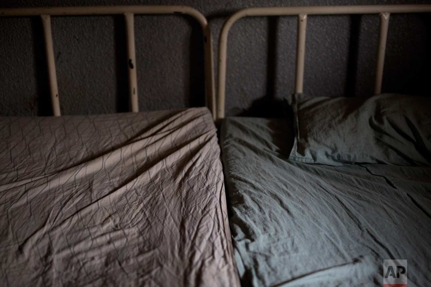 This Tuesday, Aug. 14, 2018 photo shows hospital beds at the Masaidiano Health Center in Lubumbashi, Democratic Republic of the Congo. Many hospitals lack running water and regular electricity and bed shortages are often so severe that two patients must squeeze onto a single mattress. (AP Photo/Jerome Delay)