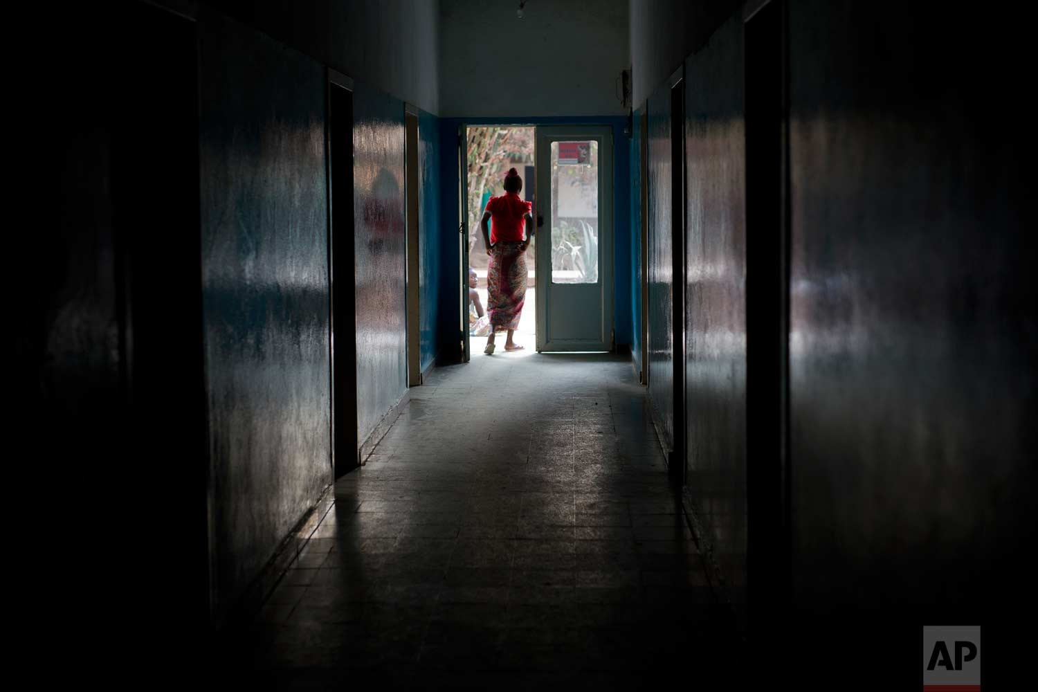 A patient stands in a doorway at the Katuba Reference Hospital in Lubumbashi, Democratic Republic of the Congo on Monday, Aug. 13, 2018. (AP Photo/Jerome Delay)