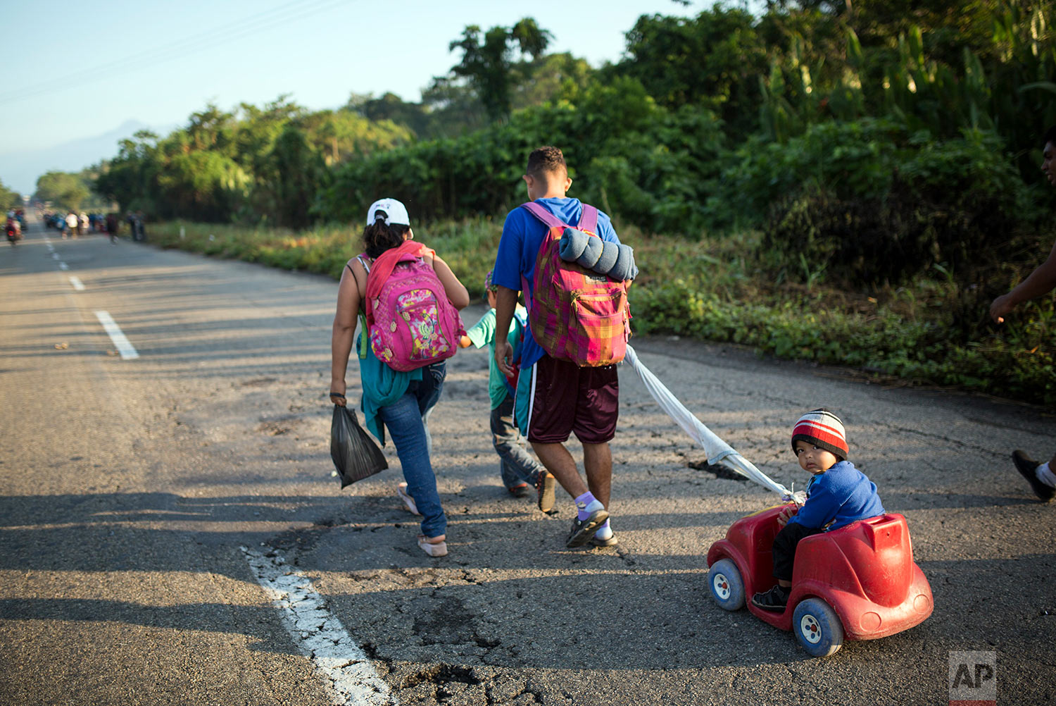 Central American migrants traveling with a caravan to the U.S. make their way to Mapastepec, Mexico, Wednesday, Oct. 24, 2018. (AP Photo/Rodrigo Abd)