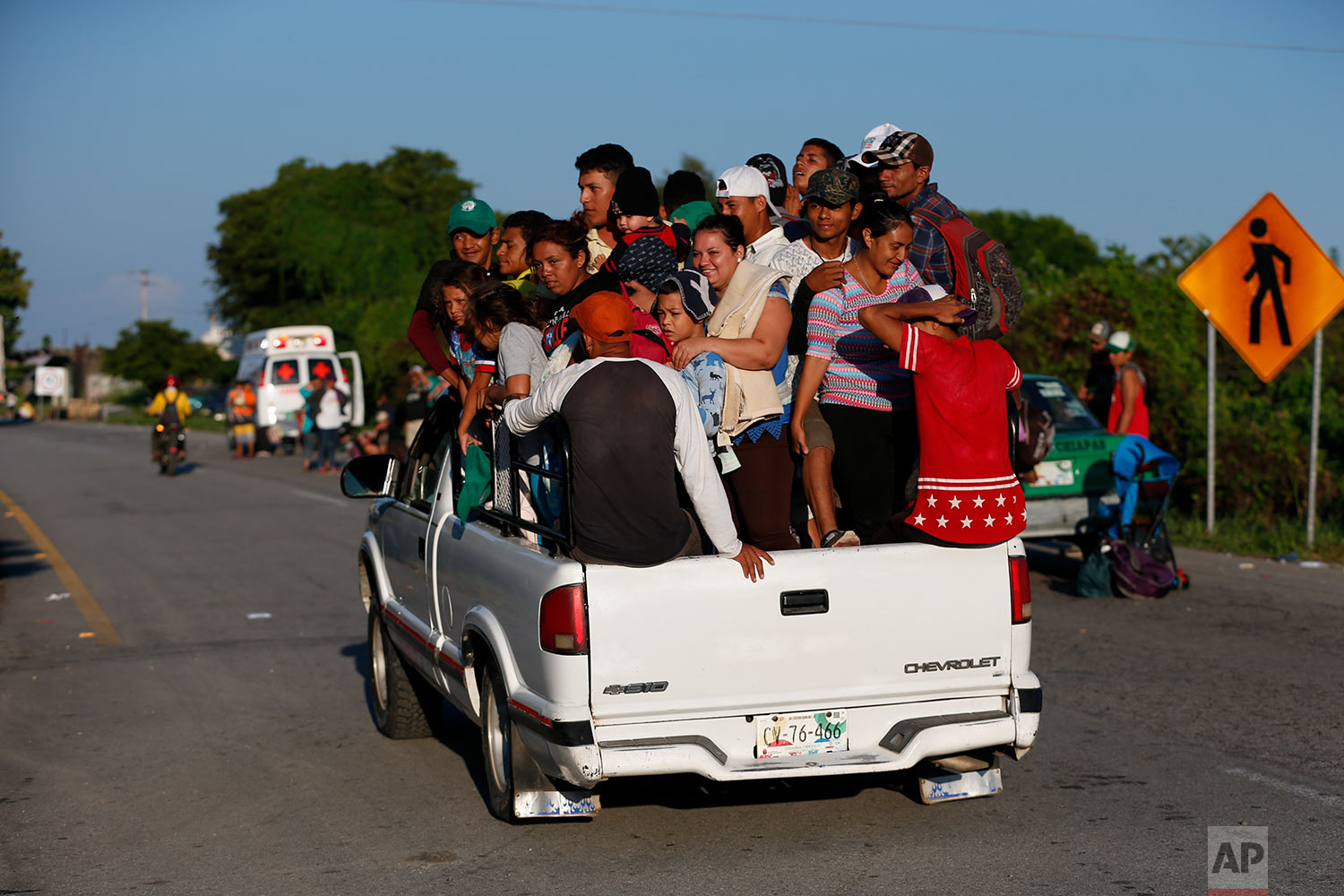Central American migrants hitch ride, as a thousands strong caravan heads north hoping to reach the U.S. border, near Mapastepec, Mexico, Thursday, Oct. 25, 2018. (AP Photo/Rebecca Blackwell)