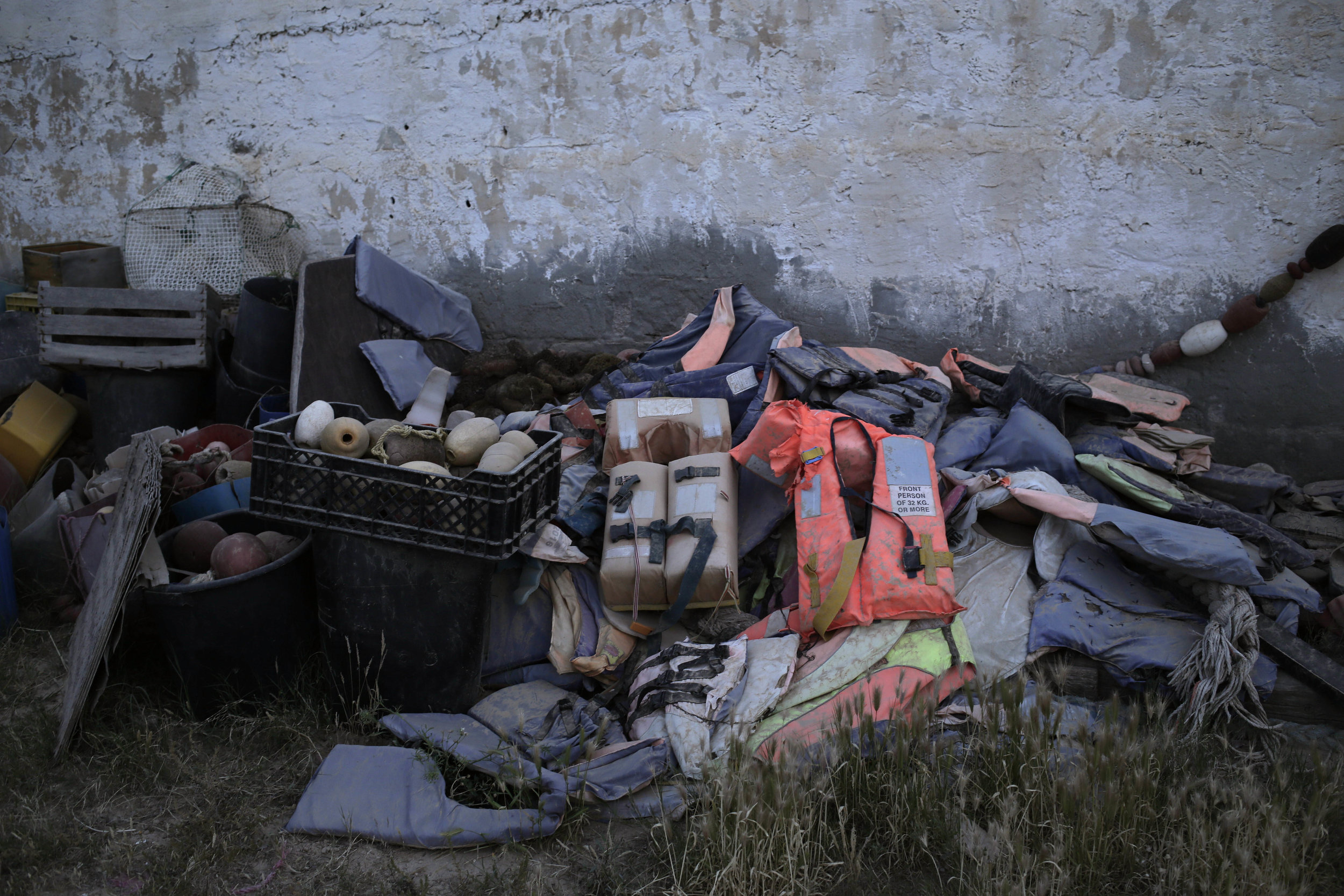 This Sunday, April 15, 2018 photo shows migrants' belongings that were collected by artist Mohsen Lahzib at his space, in the southern port town of Zarzis, Tunisia. (AP Photo/Nariman El-Mofty)