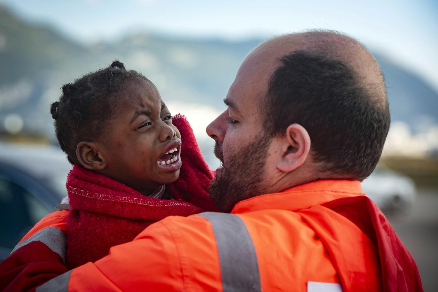 A child is carried by a member of Spain's Maritime Rescue Service as they arrive at the port of San Roque, southern Spain, after being rescued in the Strait of Gibraltar on Saturday, Oct. 27, 2018. The organization saved 520 people trying to cross from Africa to Spain's shores on Saturday. Also, one boat with 70 migrants arrived to the Canary Islands. Over 1,960 people have died trying to cross the Mediterranean to Europe this year, according to the United Nations. (AP Photo/Marcos Moreno)