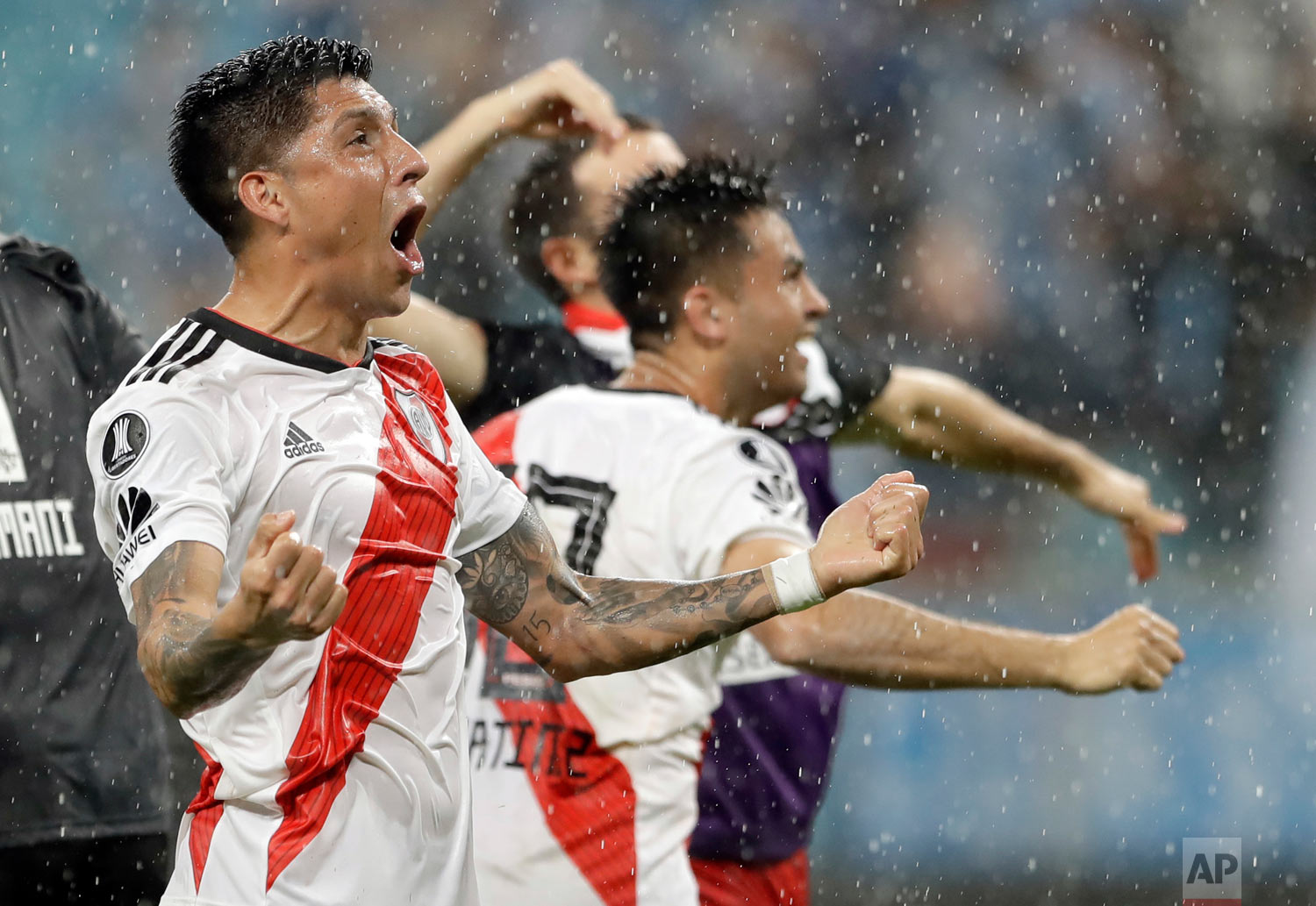 Argentina's River Plate players celebrate defeating Brazil's Gremio at a Copa Libertadores semifinal second leg match in Porto Alegre, Brazil, Oct. 30, 2018. River advances to the finals. (AP Photo/Andre Penner)