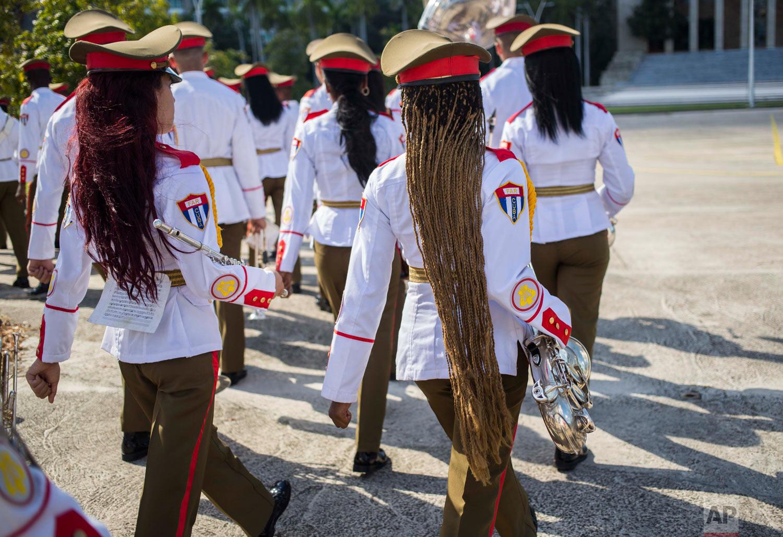 The honor guard military band marches after the arrival of El Salvador's President Salvador Sanchez Ceren at Revolution Square in Havana, Cuba, Oct. 25, 2018. (AP Photo/Desmond Boylan)
