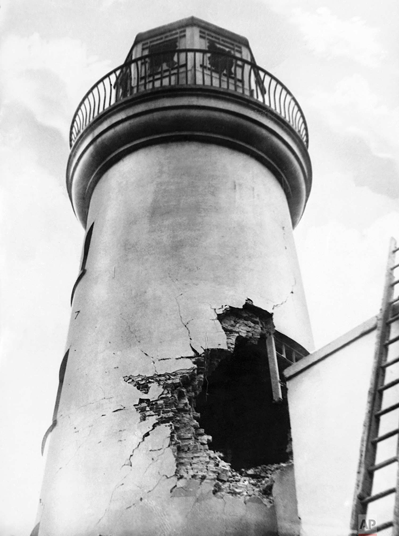 In this Dec. 1914 photo, damage from German bombardment to the lighthouse in Scarborough, England during World War One. (AP Photo)