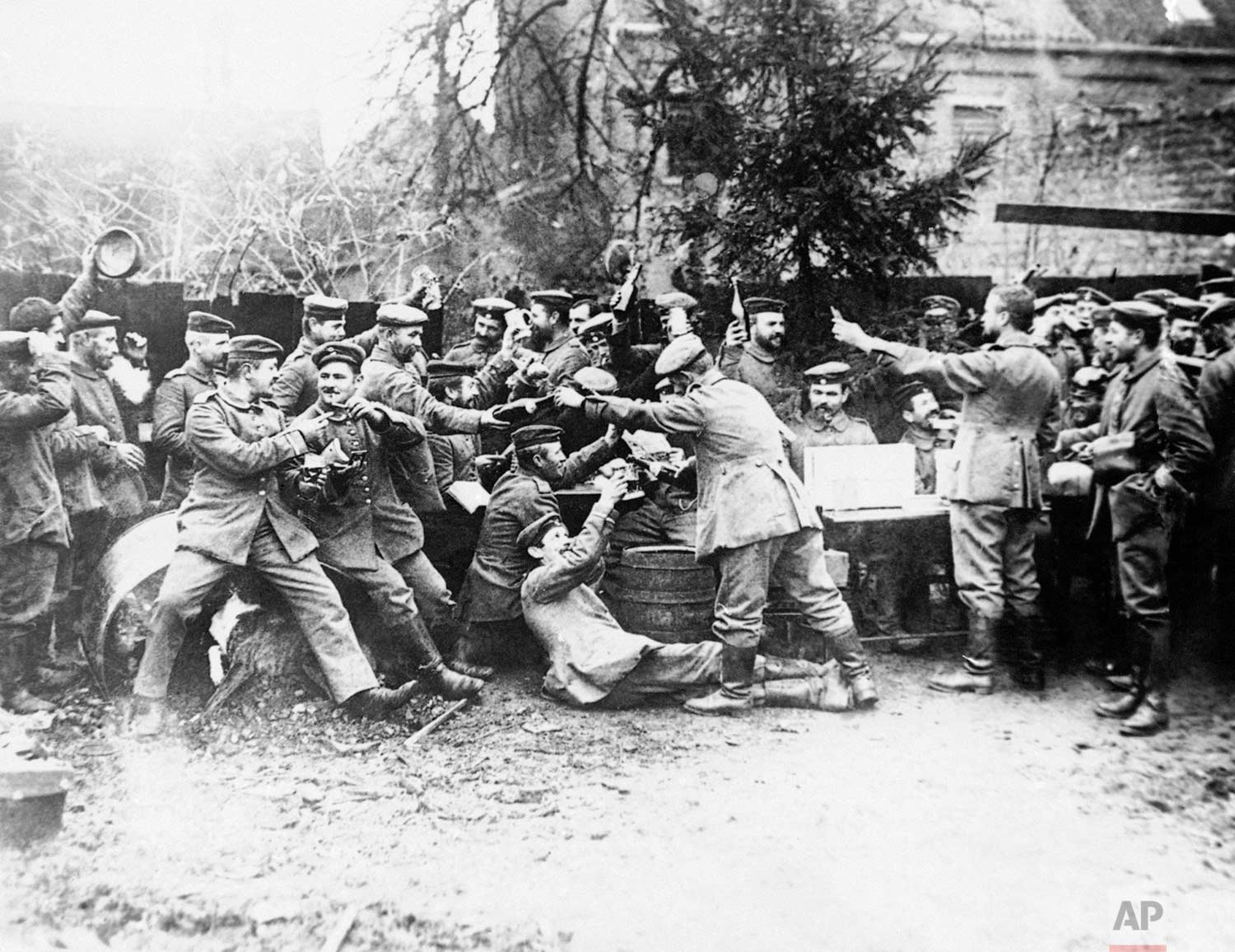 In this 1914 photo, German soldiers gather at Christmas at an unknown location during World War One. (AP Photo)