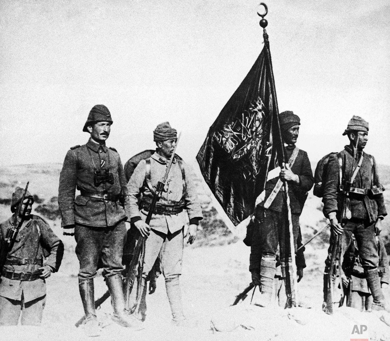 In this 1915 photo, Turkish soldiers raise their flag at Kanli Sirt, Gallipoli, Turkey during World War One. (AP Photo)