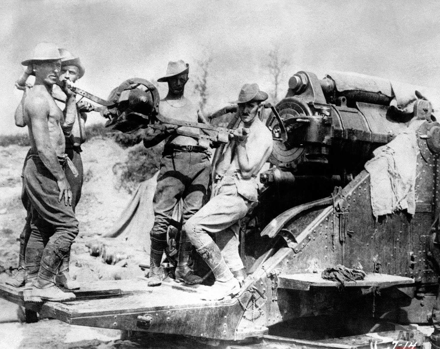 In this 1916 photo, Australian artillery soldiers operate a large caliber gun at the Somme front, in France during World War One. (AP Photo)