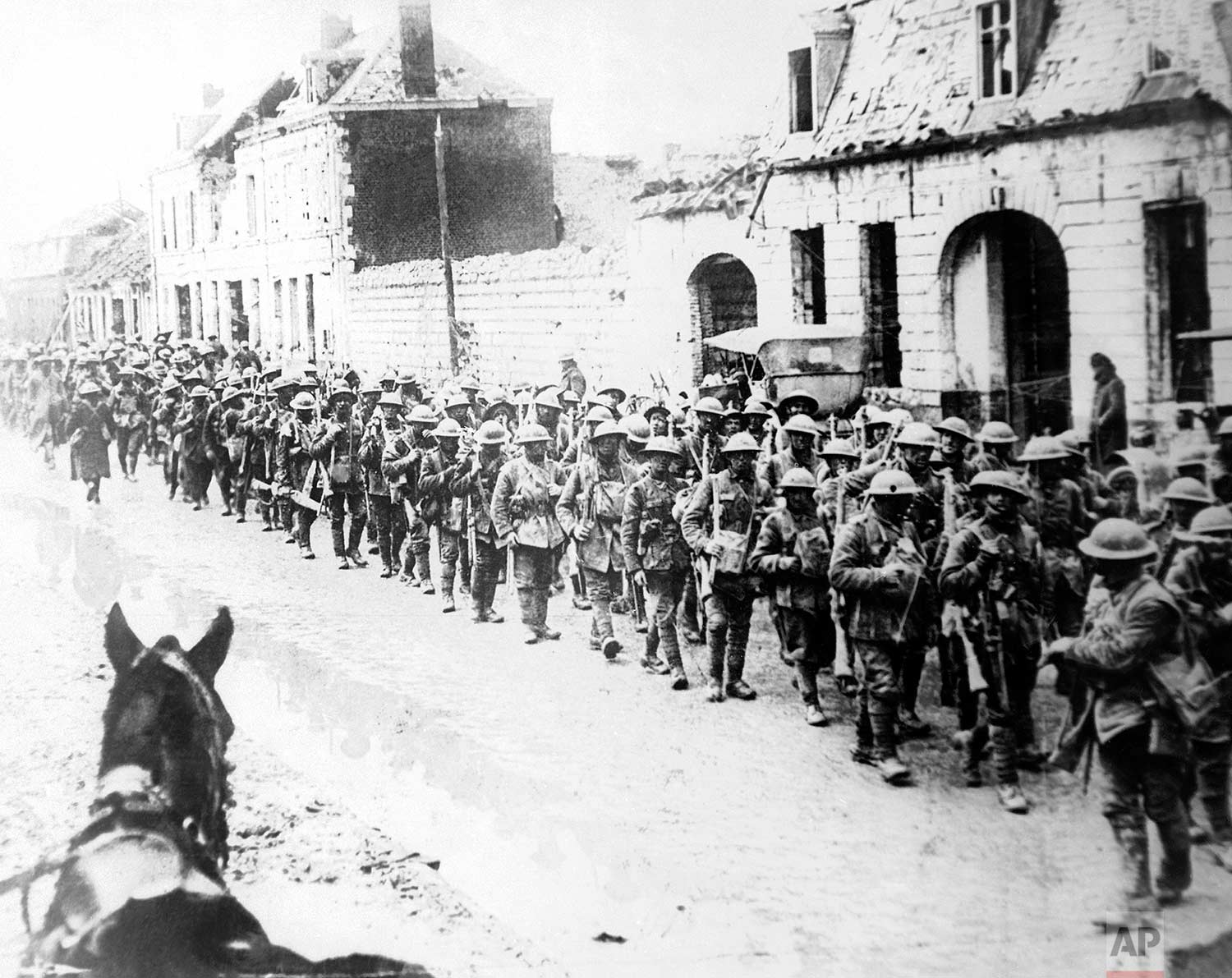In this 1917 photo, British World War One soldiers return in formation to Ypres, Belgium. (AP Photo)