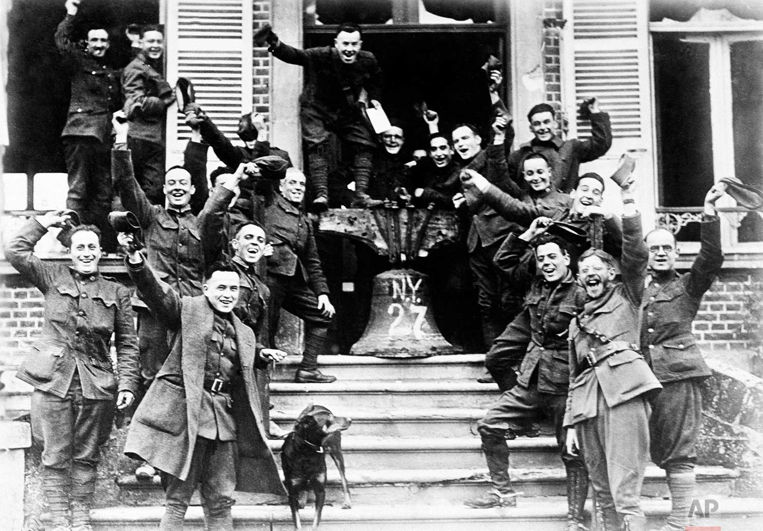 In this Nov. 1918 photo, American soldiers from New York, who served on the frontline in Cambria, France, rig up a Liberty Bell to celebrate the signing of the Armistice to end World War One. (AP Photo)