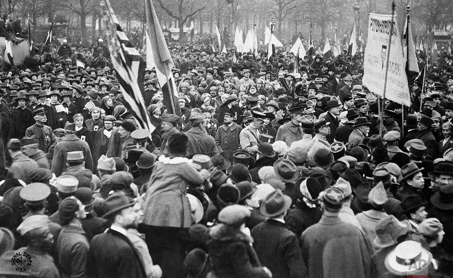 In this Nov. 11, 1918 photo, people in the streets of Paris, France, celebrate the signing of the Armistice that ended the fighting of World War One. (AP Photo)