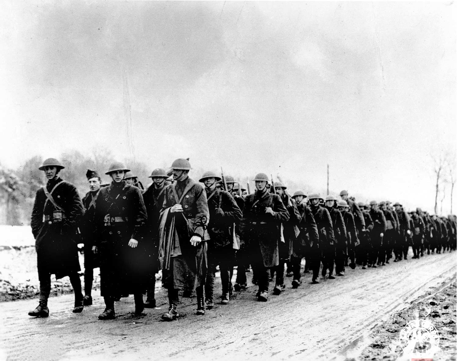 In this March 1918 photo, American soldiers of Company K, 165th Infantry of the Fighting 69th, Old Rainbow Division, march to the trenches at St. Clement, France during World War One. (AP Photo)