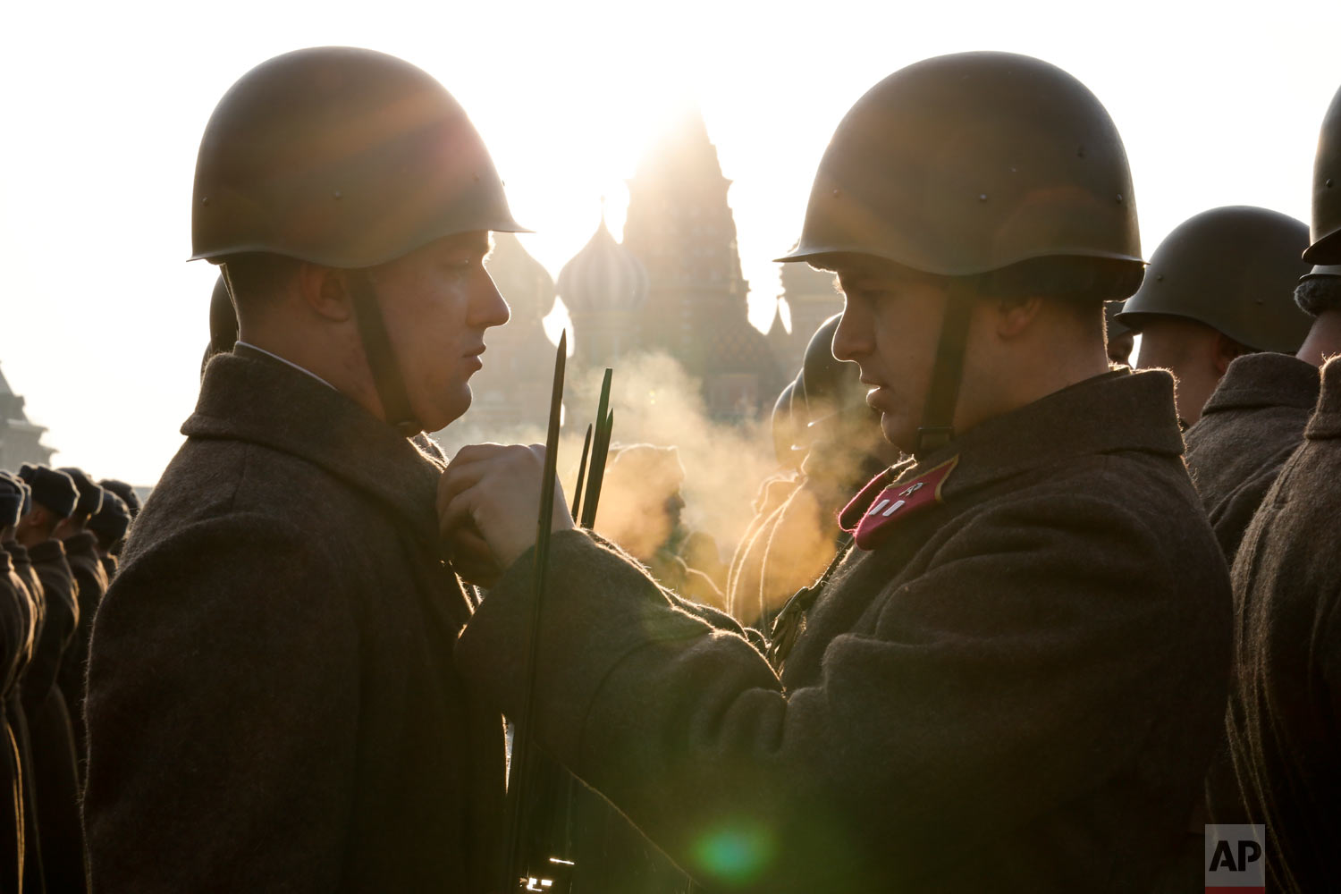 Russian soldiers dressed in Red Army World War II uniforms prepare to the start of the Nov. 7 parade in Red Square, with St. Basil Cathedral in the background, in Moscow, Russia, Wednesday, Nov. 7, 2018. The event marked the 77th anniversary of a World War II historic parade in Red Square and honored the participants in the Nov. 7, 1941 parade who headed directly to the front lines to defend Moscow from the Nazi forces. (AP Photo/Alexander Zemlianichenko)