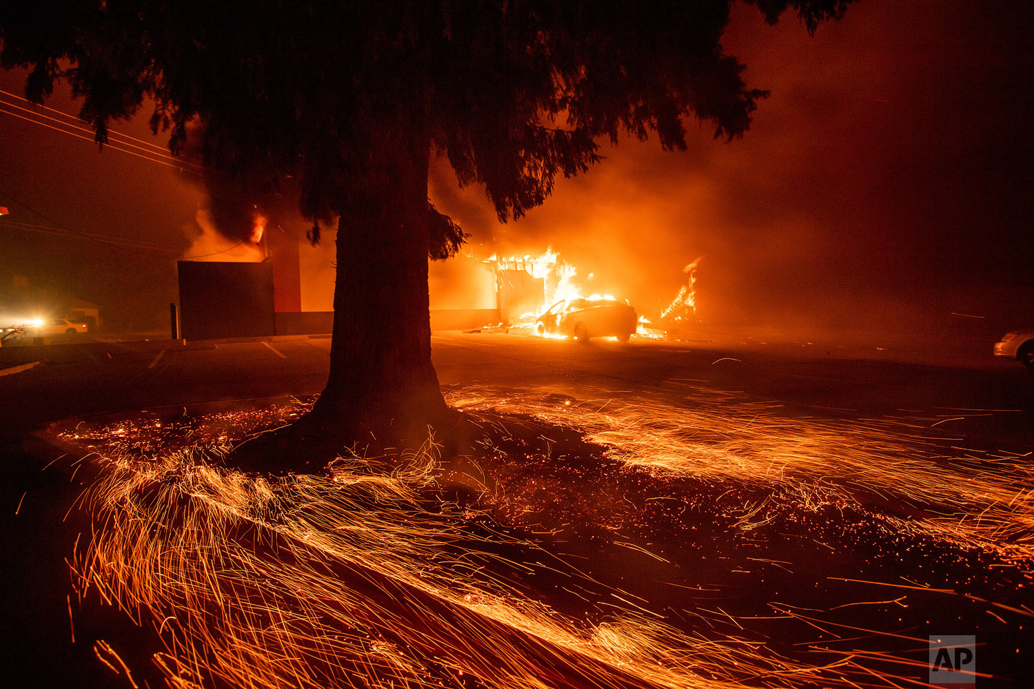 Flames consume a fast food restaurant as the Camp Fire tears through Paradise, Calif., on Thursday, Nov. 8, 2018. The fire incinerated most of a town of about 30,000 people with flames that moved so fast there was nothing firefighters could do, authorities said Friday, Nov. 9, 2018. (AP Photo/Noah Berger)