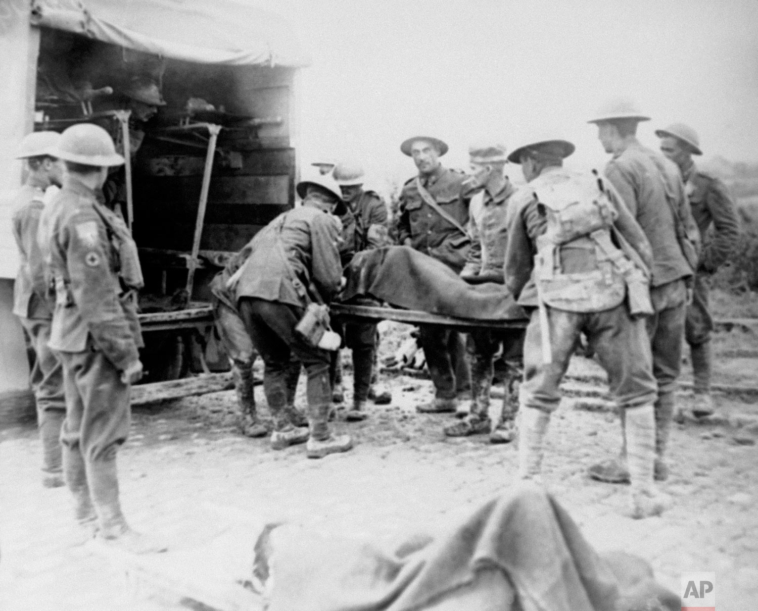 Wounded World War One soldiers are placed in ambulance during the advance on Lens, France. (AP Photo)
