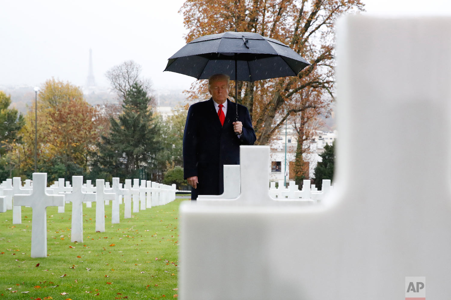 President Donald Trump stands amongst the headstones during an American Commemoration Ceremony Nov. 11, 2018, at Suresnes American Cemetery near Paris. (AP Photo/Jacquelyn Martin)