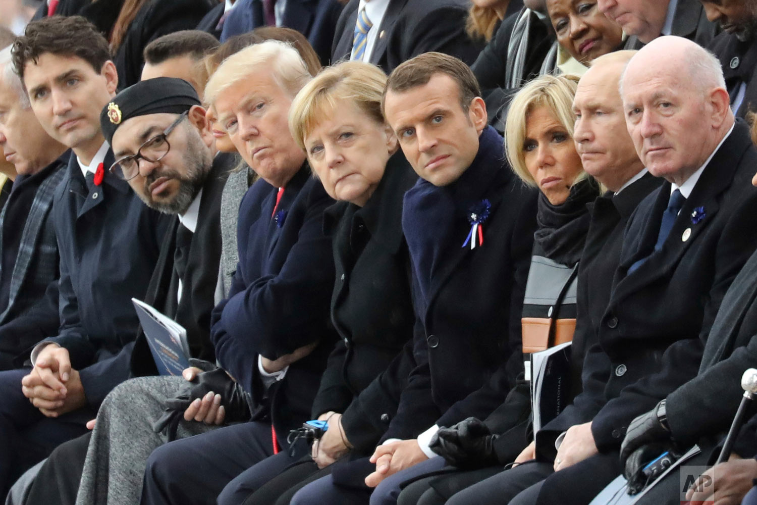 Canadian Prime Minister Justin Trudeau, from left, Morocco's Prince Moulay Hassan, Moroccan King Mohammed VI, US First Lady Melania Trump, US President Donald Trump, German Chancellor Angela Merkel, French President Emmanuel Macron and his wife Brigitte Macron, Russian President Vladimir Putin and Australian Governor-General Peter Cosgrove attend a ceremony the Arc de Triomphe in Paris, France, as part of the commemorations marking the 100th anniversary of the 11 November 1918 armistice, ending World War I, Nov. 11, 2018. (Ludovic Marin/Pool Photo via AP)